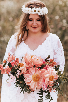Wedding day bridal portrait with daisy chain headpiece, a bouquet with shades of pink and custom Patti Flowers gown at Trinity River Audubon Center in Dallas, Texas by After Yes