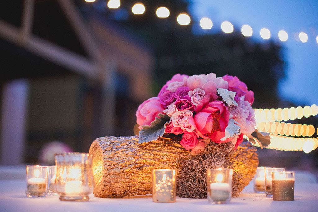 Cafe Lights and Gold Glitter Votives with tree log at Dallas Heritage Village Wedding