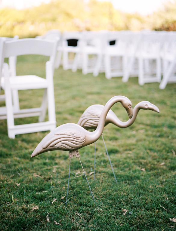 Gold flamingo lawn ornaments used for wedding decor at The Belmont Hotel