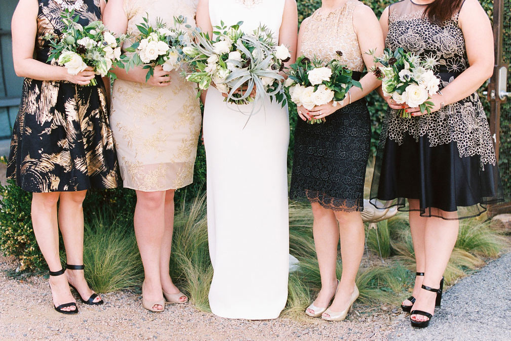 Bridal party in black and gold dresses at The Belmont Hotel