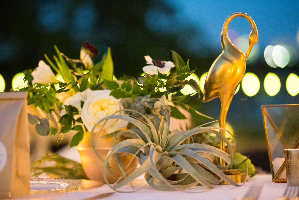 Gold flamingo and candle wedding reception table centerpiece