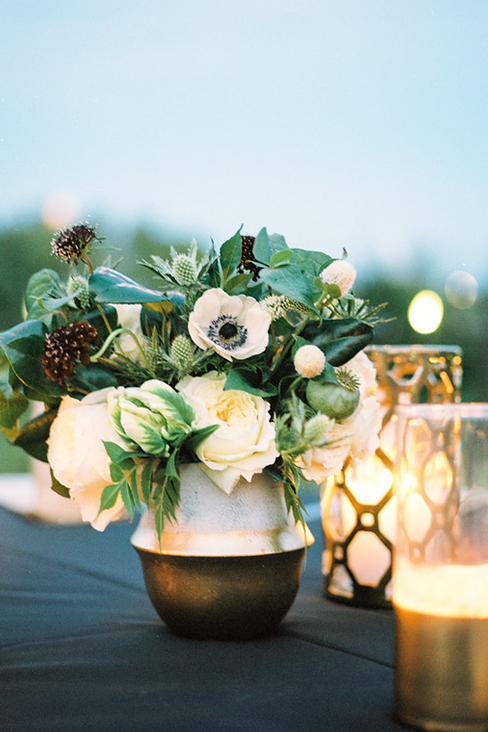 Gold and white wedding reception table centerpiece