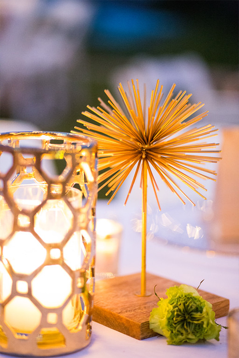 Gold starburst and candle wedding centerpiece