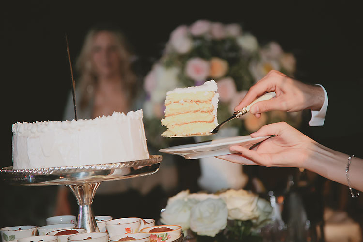 Italing cream cake at wedding reception