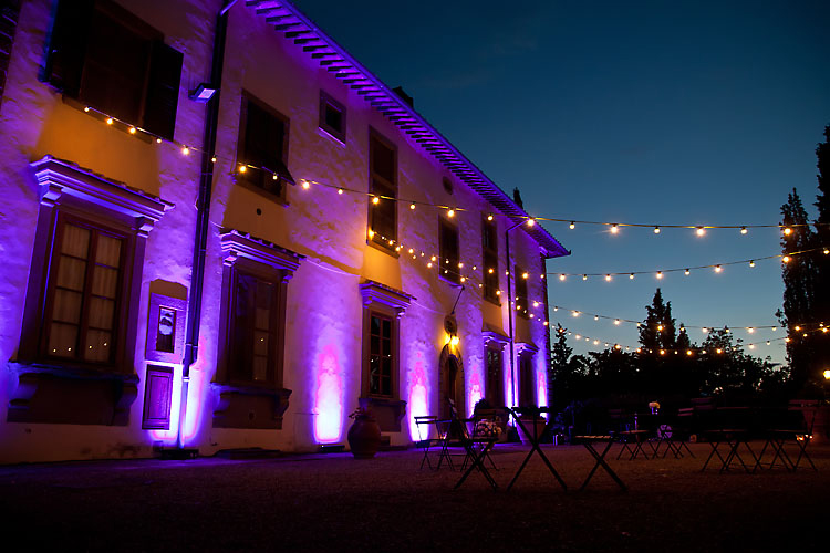 Cafe lights at wedding reception at Castello Vicchiomaggio Italy Destination Wedding