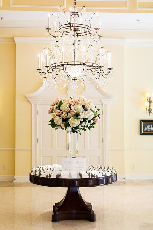 Arlington Hall guest table with wedding centerpiece and escort cards