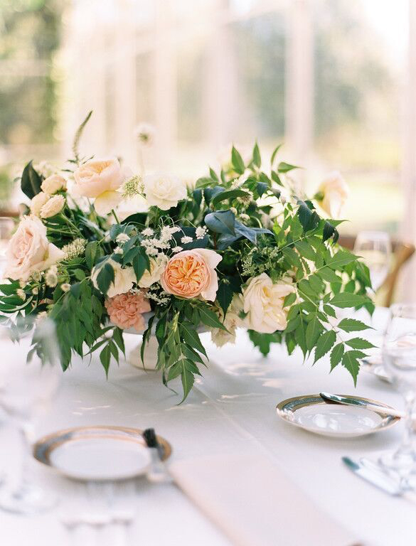 Peach and white low lush wedding centerpiece