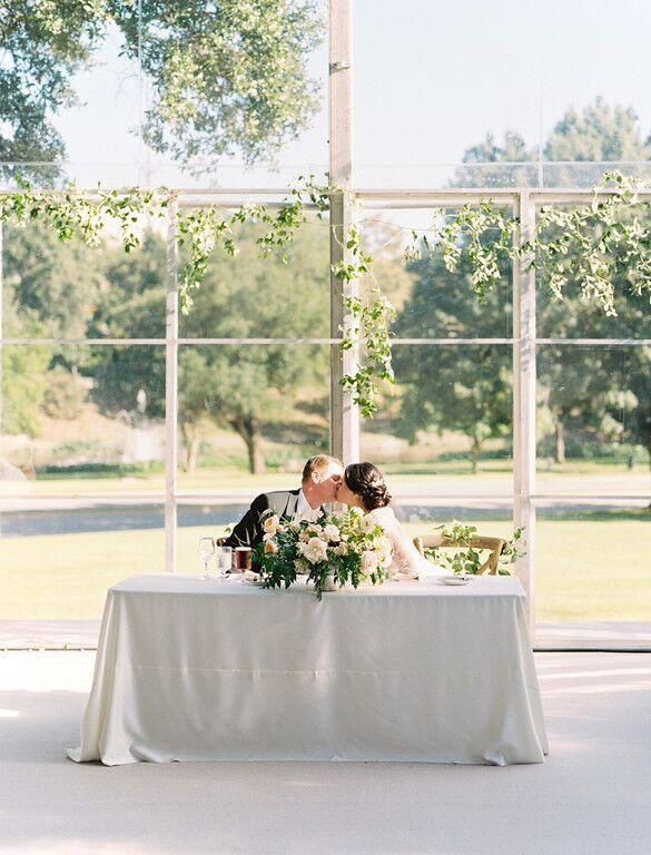Bride and groom at rectangle sweetheart table