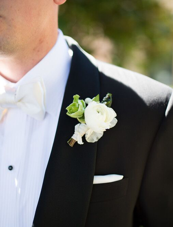 White ranunculus and greenery grooms boutonniere