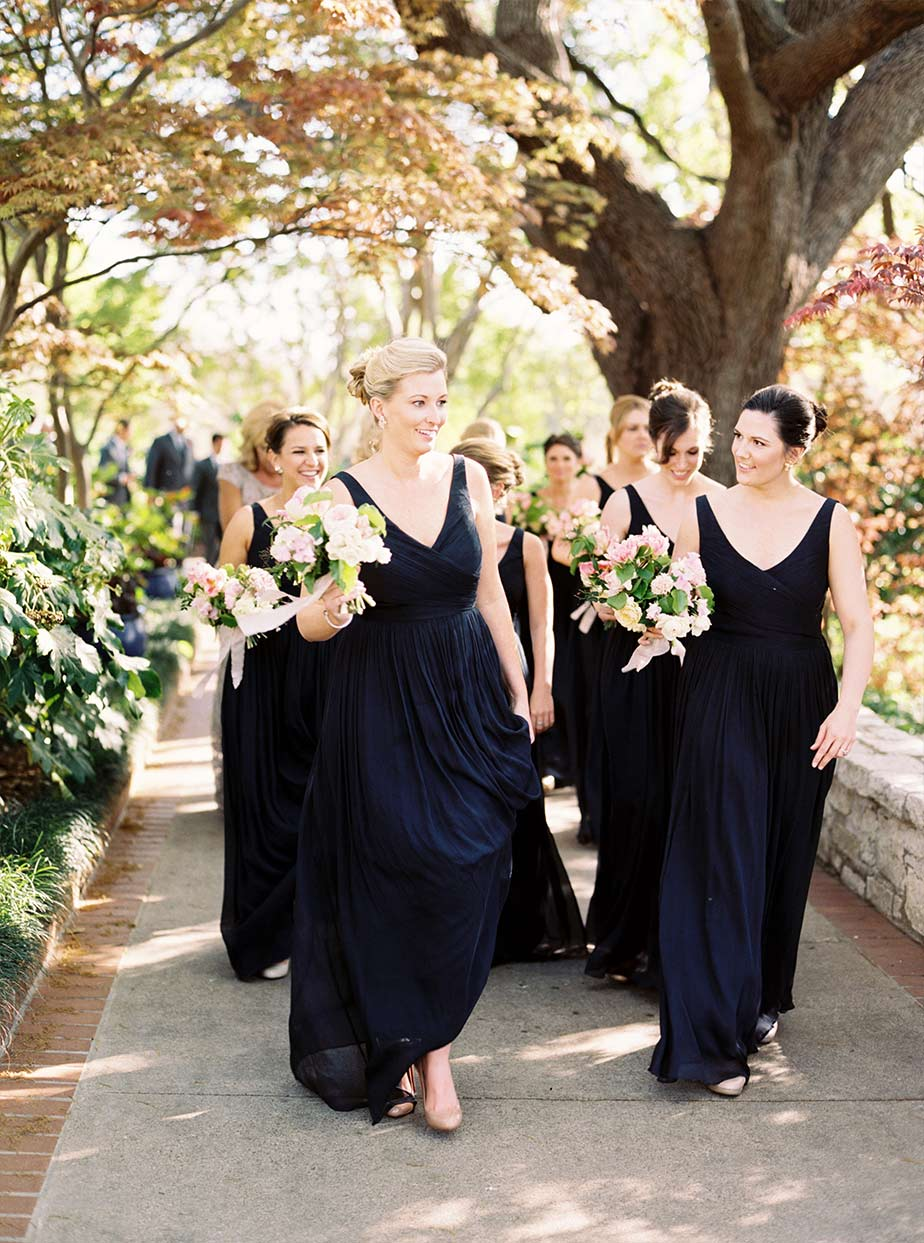 Bridal party in navy long dresses at The Dallas Arboretum