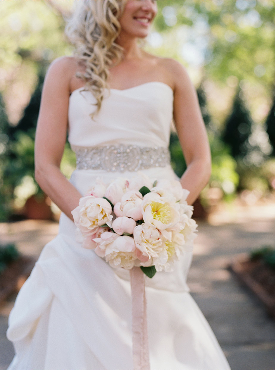 Bridal portrait with white streamer bouquet