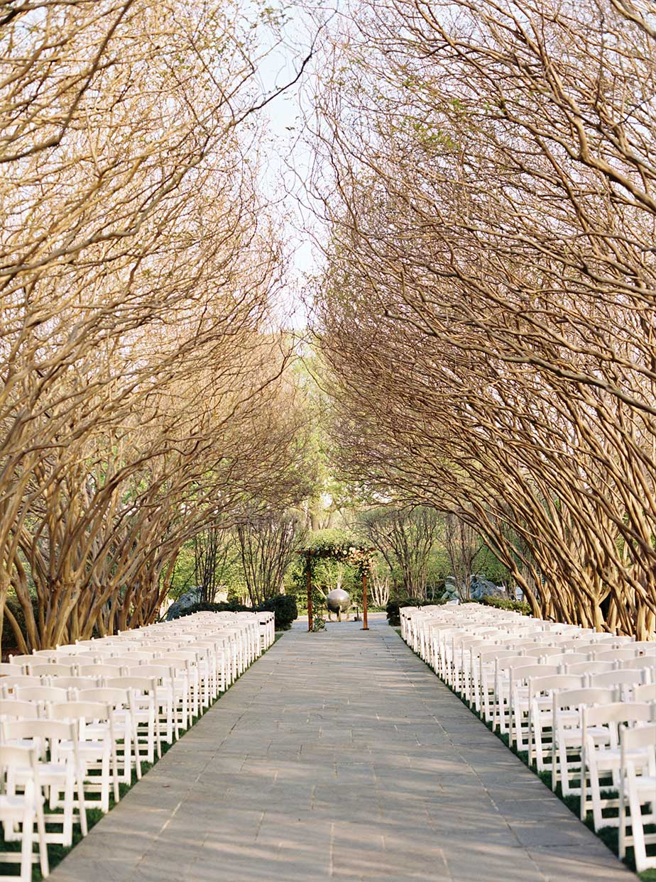 Wedding ceremony setup at Crate Myrtle Allee at The Dallas Arboretum