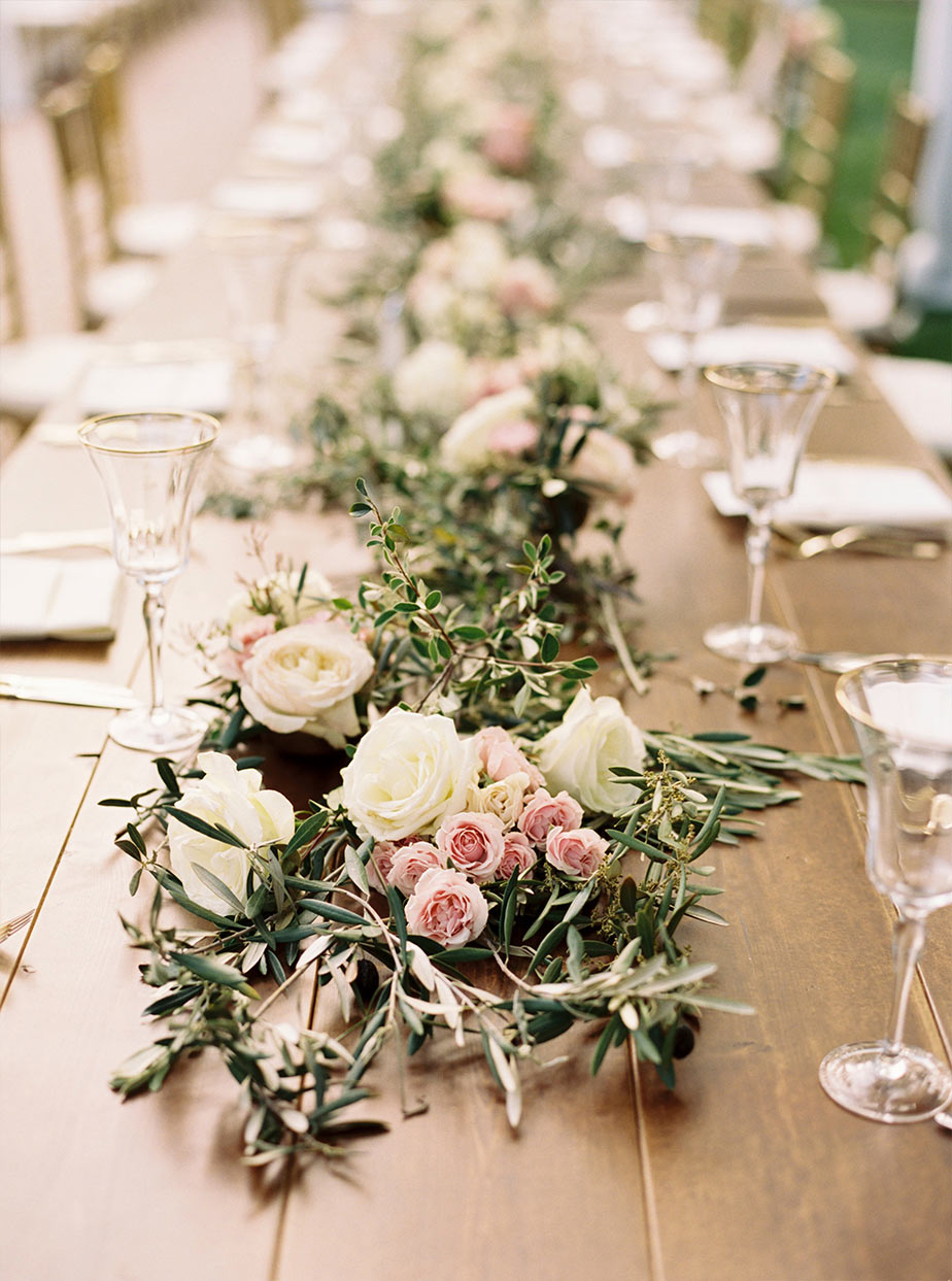 Wooden wedding reception head table floral garland