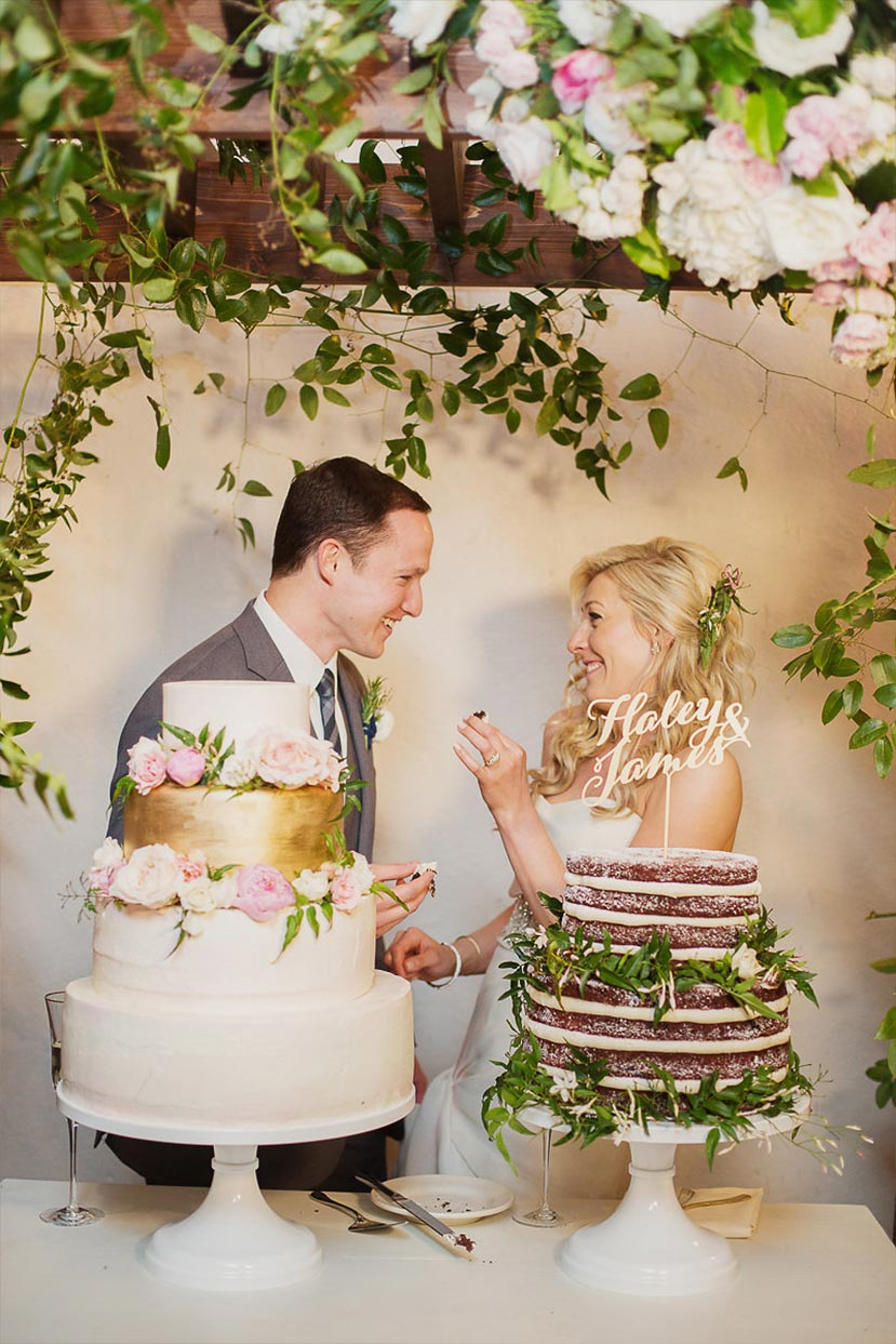 Bride and groom cut their wedding cakes at The Degolyer House at The Dallas Arboretum