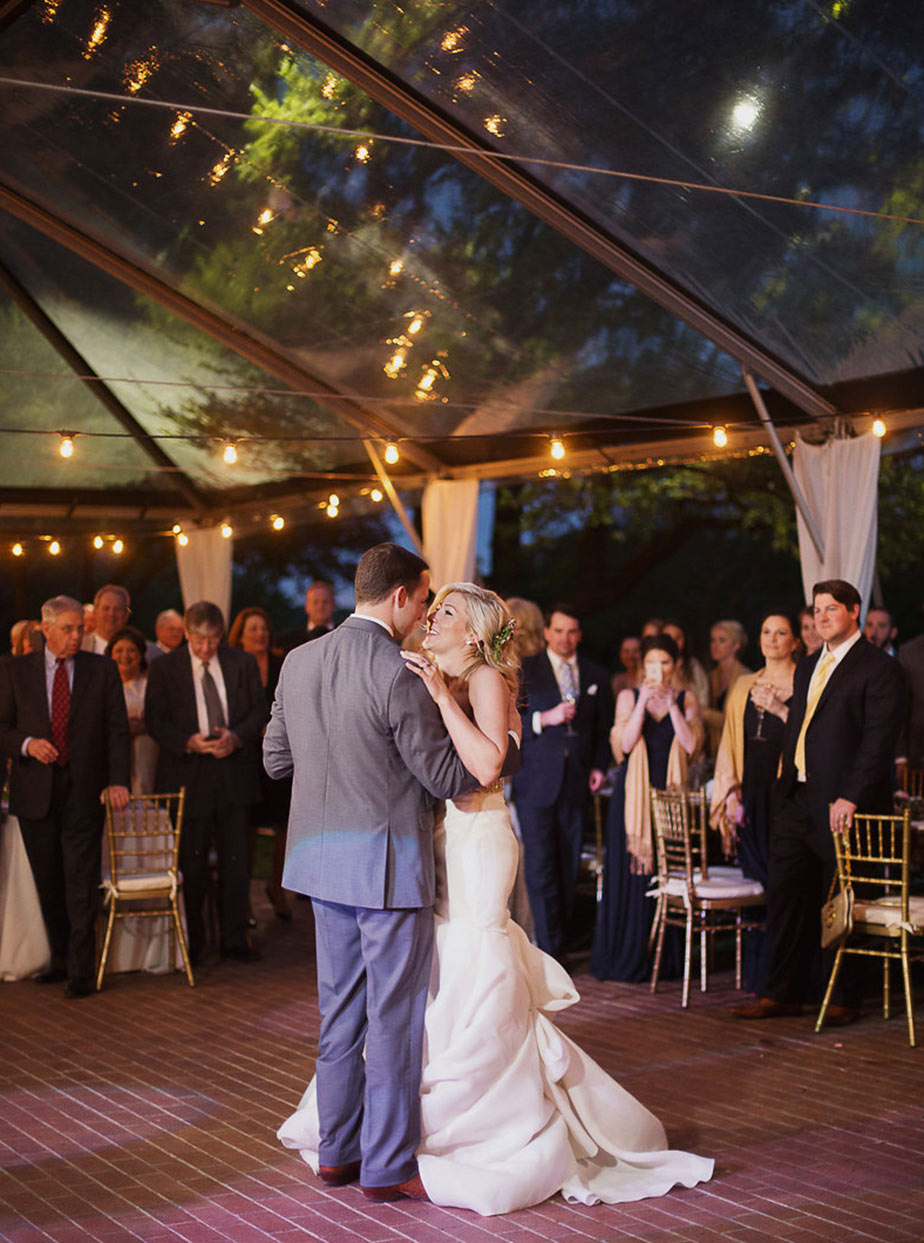 Bride and groom first dance under clear tent