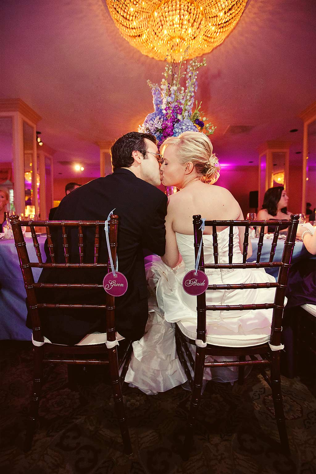 walnut chiavari chairs with bride and groom signs