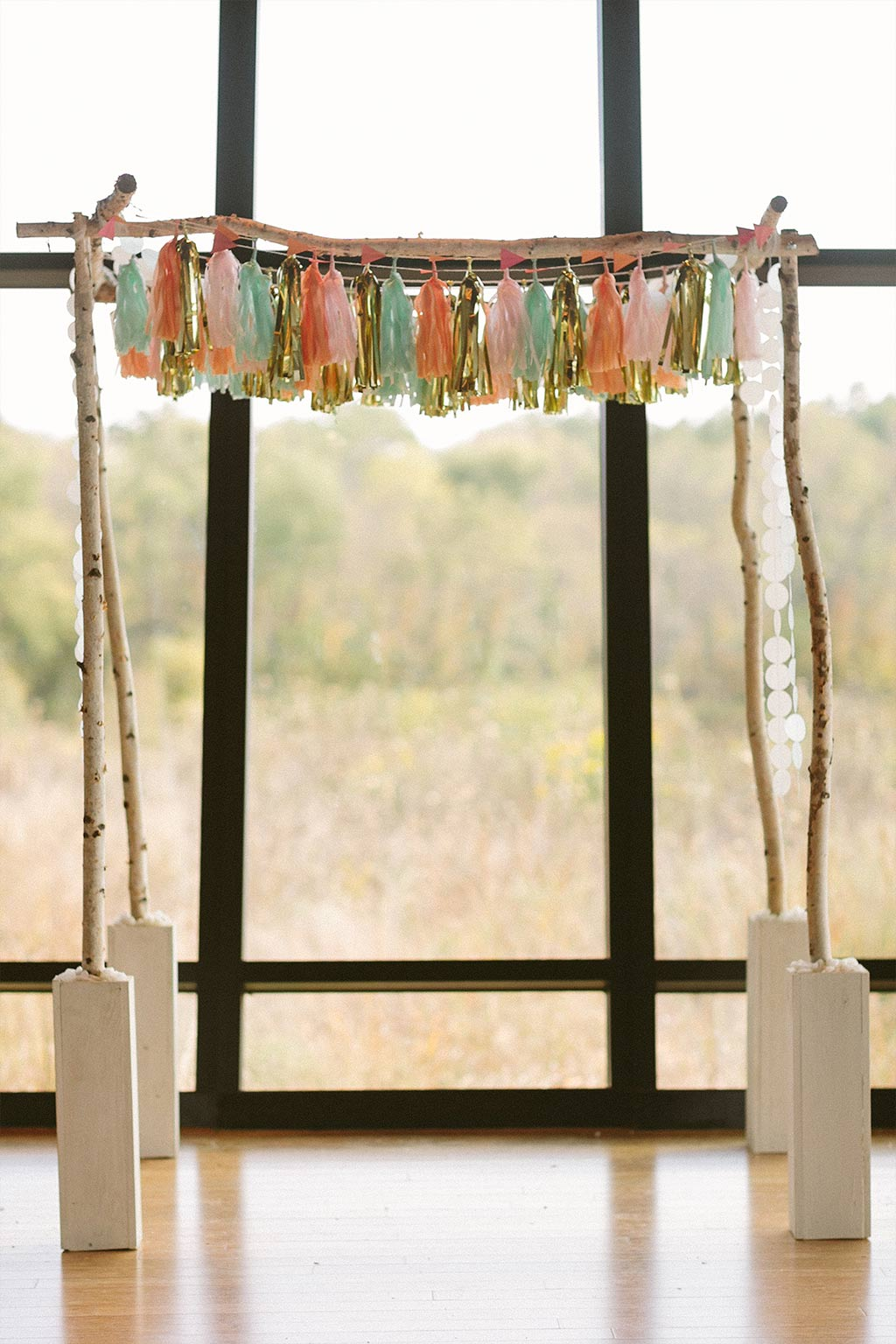 Wedding chuppah with paper tassels and garlands