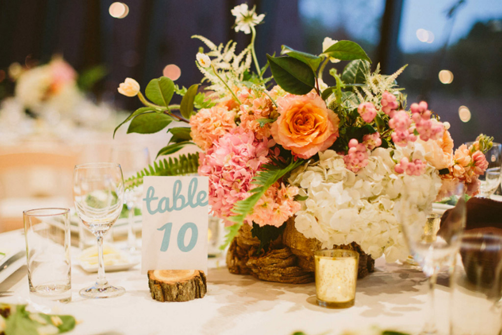 Blue calligraphy table number with low wedding centerpiece