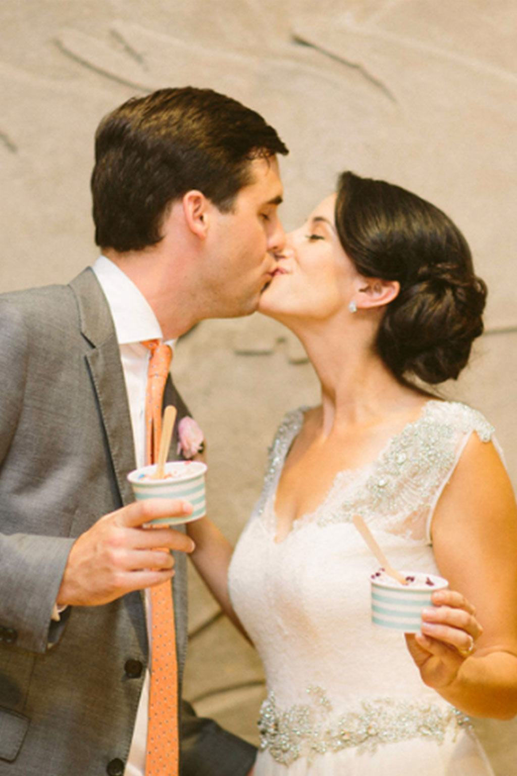 Bride and groom kiss with Carnival Barkers ice cream cups