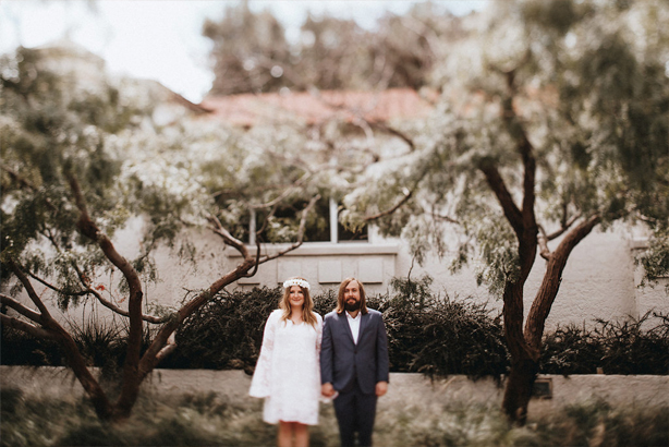 Bride and groom take a wedding day portrait at the Trinity River Audubon Center in Dallas