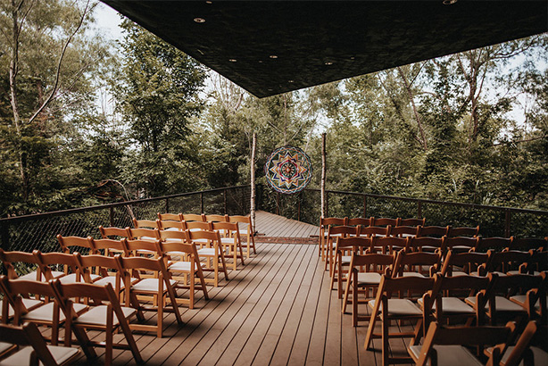 Wedding reception with colorful altar decoration at the Trinity River Audubon Center in Dallas