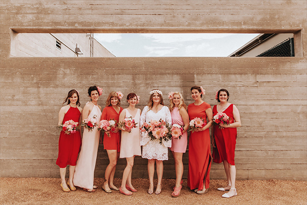Mix-match bridal party in reds and pinks at the Trinity River Audubon Center in Dallas