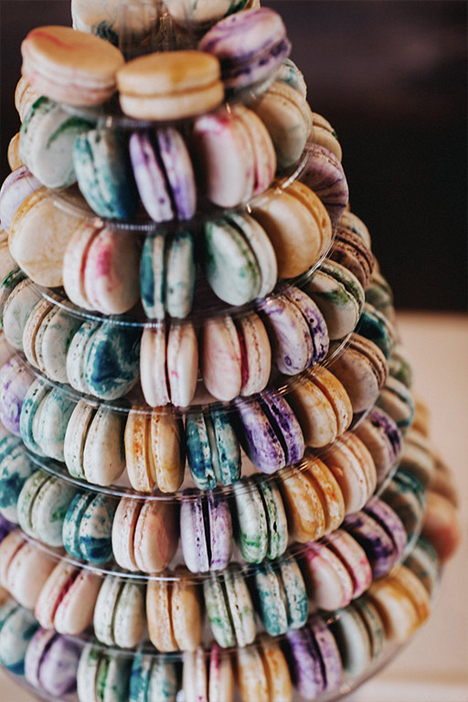 A colorful french macaroon tower at the wedding reception