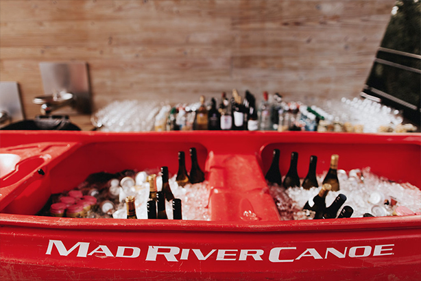 A red Mad River canoe turned into a bar at the wedding reception