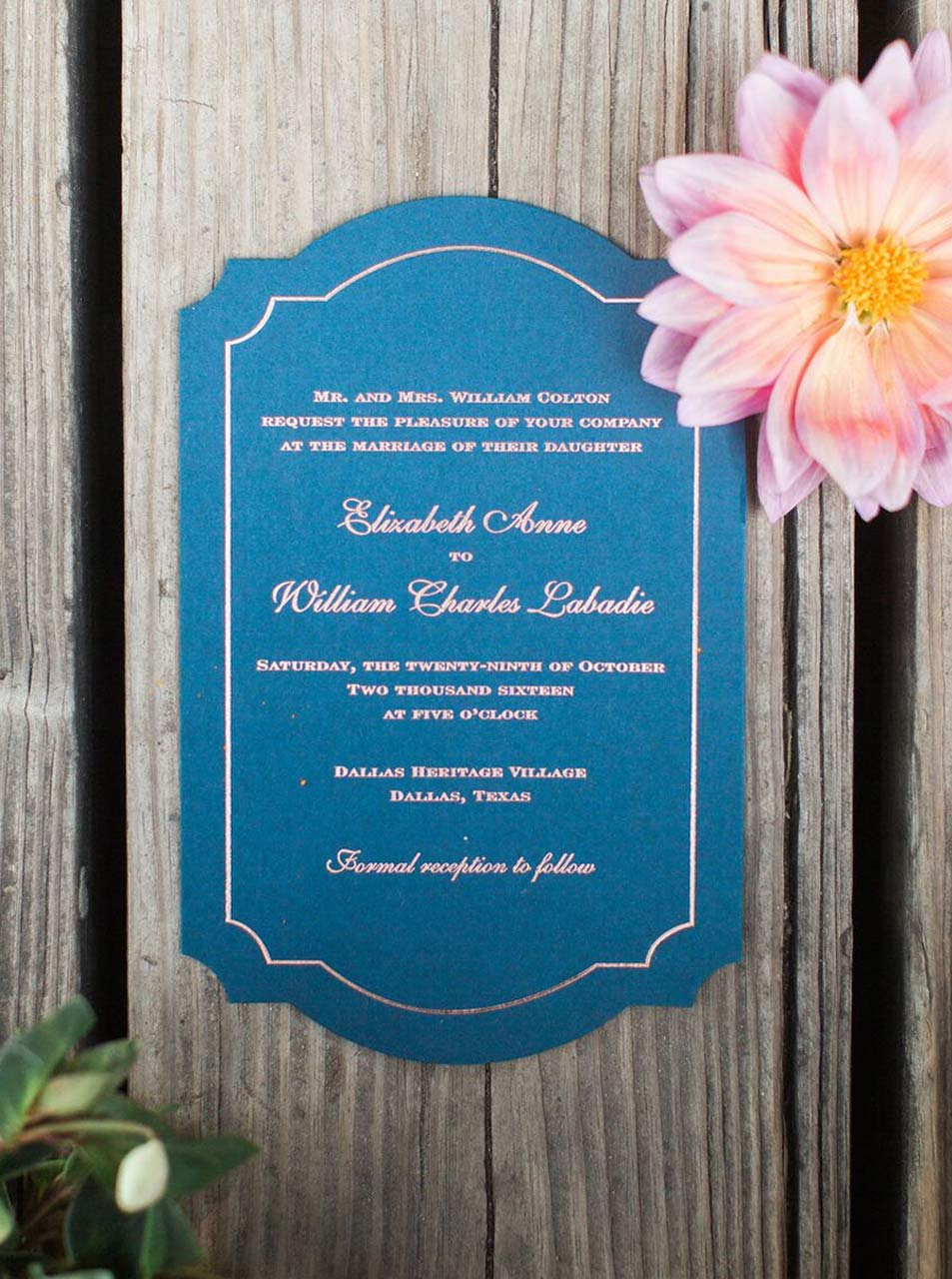 Die cut navy and rose gold wedding invitation