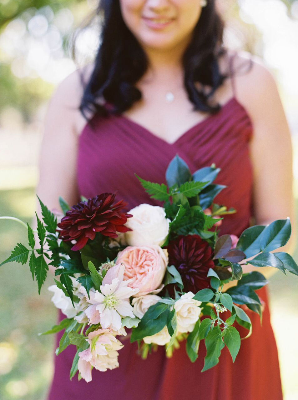 Bridesmaid bouquet peach and dark plum with chiffon dress