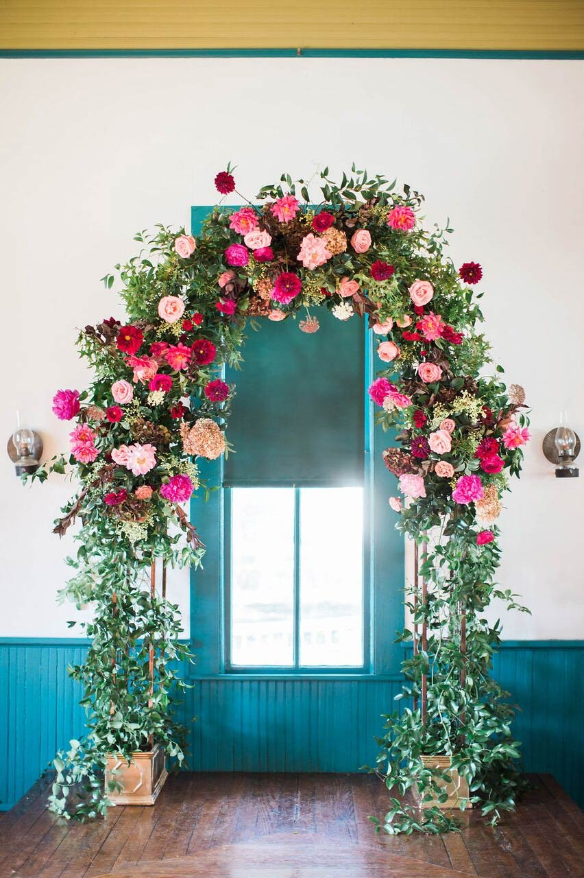 Floral and greenery wedding ceremony arch