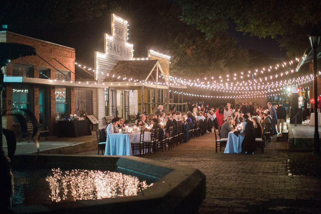 Dallas Heritage Village Wedding reception at night on Main Street with cafe lights