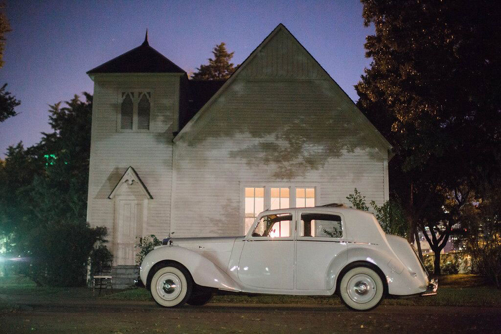 White vintage classic car at Dallas wedding reception