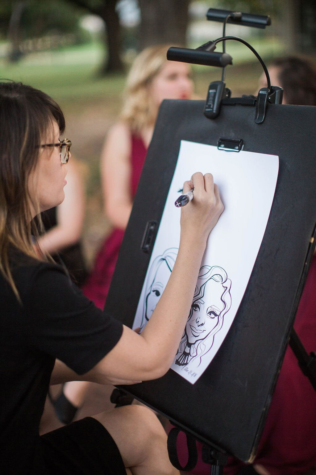 Caricature artist at Dallas wedding reception