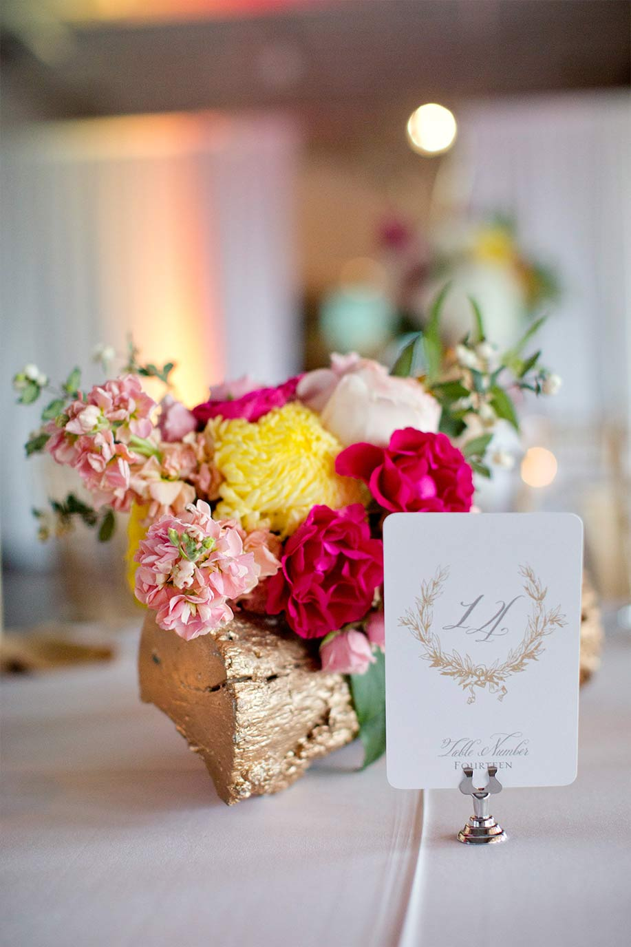 Gold log wedding centerpiece and laurel wreath table number