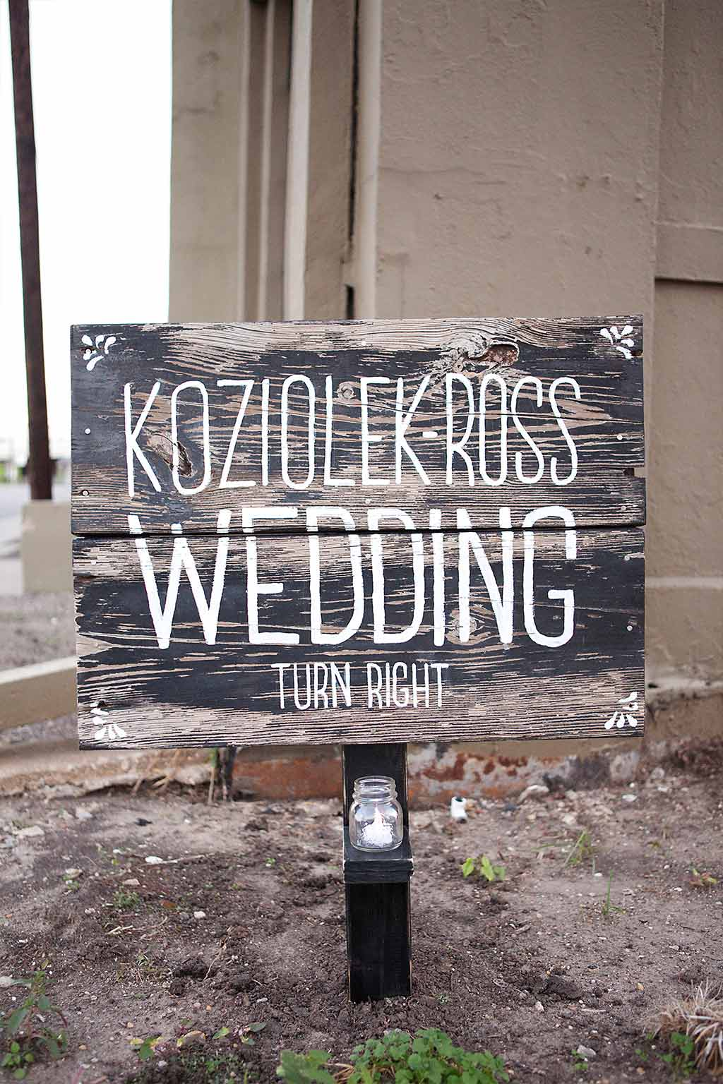 worn wood hand painted wedding sign with votive candle