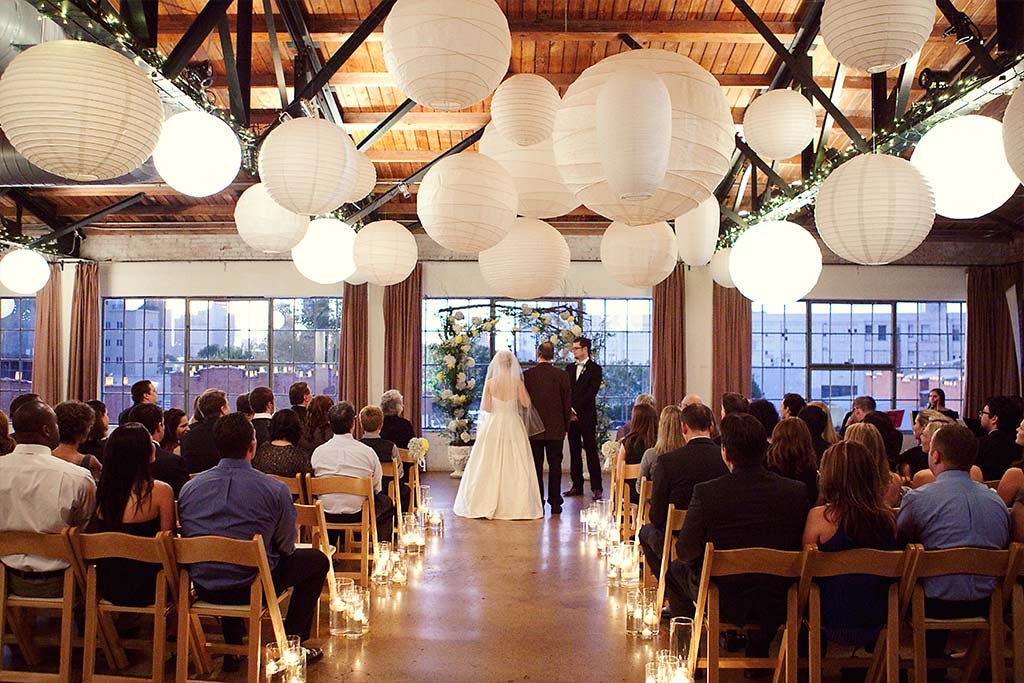 industrial loft wedding ceremony with lanterns at Hickory Street Annex in Dallas