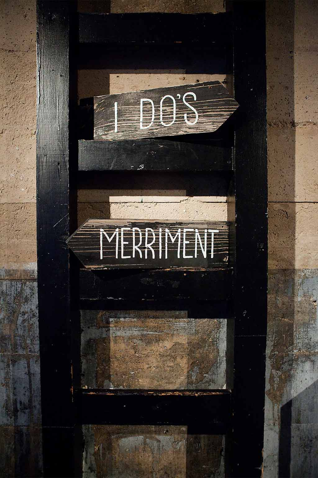 I Dos and Merriment direction hand painted wedding signs