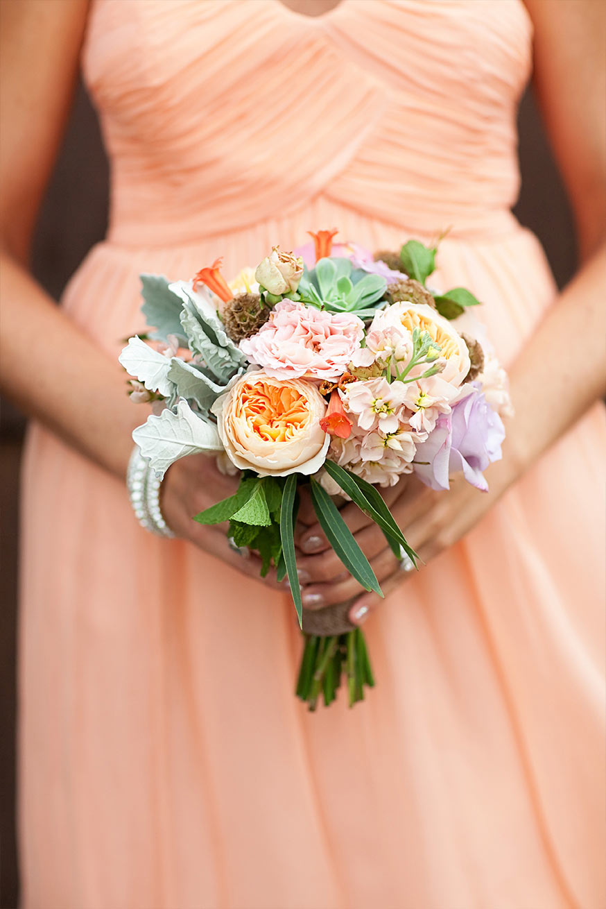 peach bridesmaids' dress and bouquet
