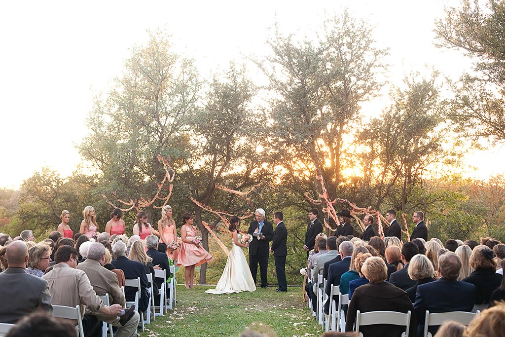 sunset farm wedding ceremony with BHLDN streamers