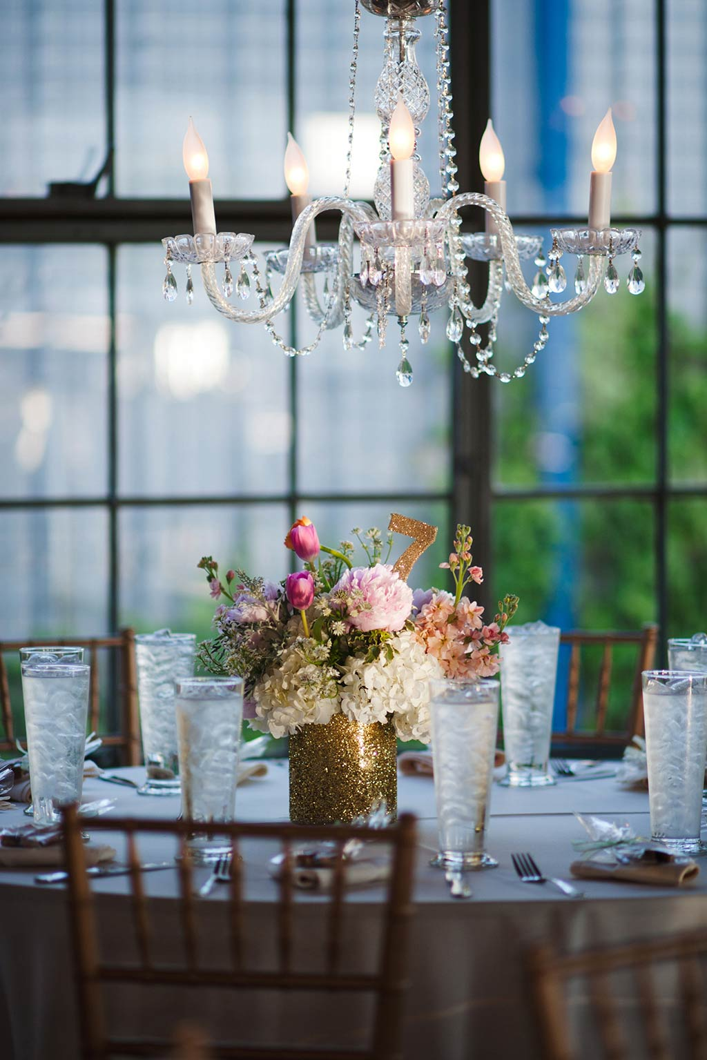 Chandelier above Wedding Reception Table