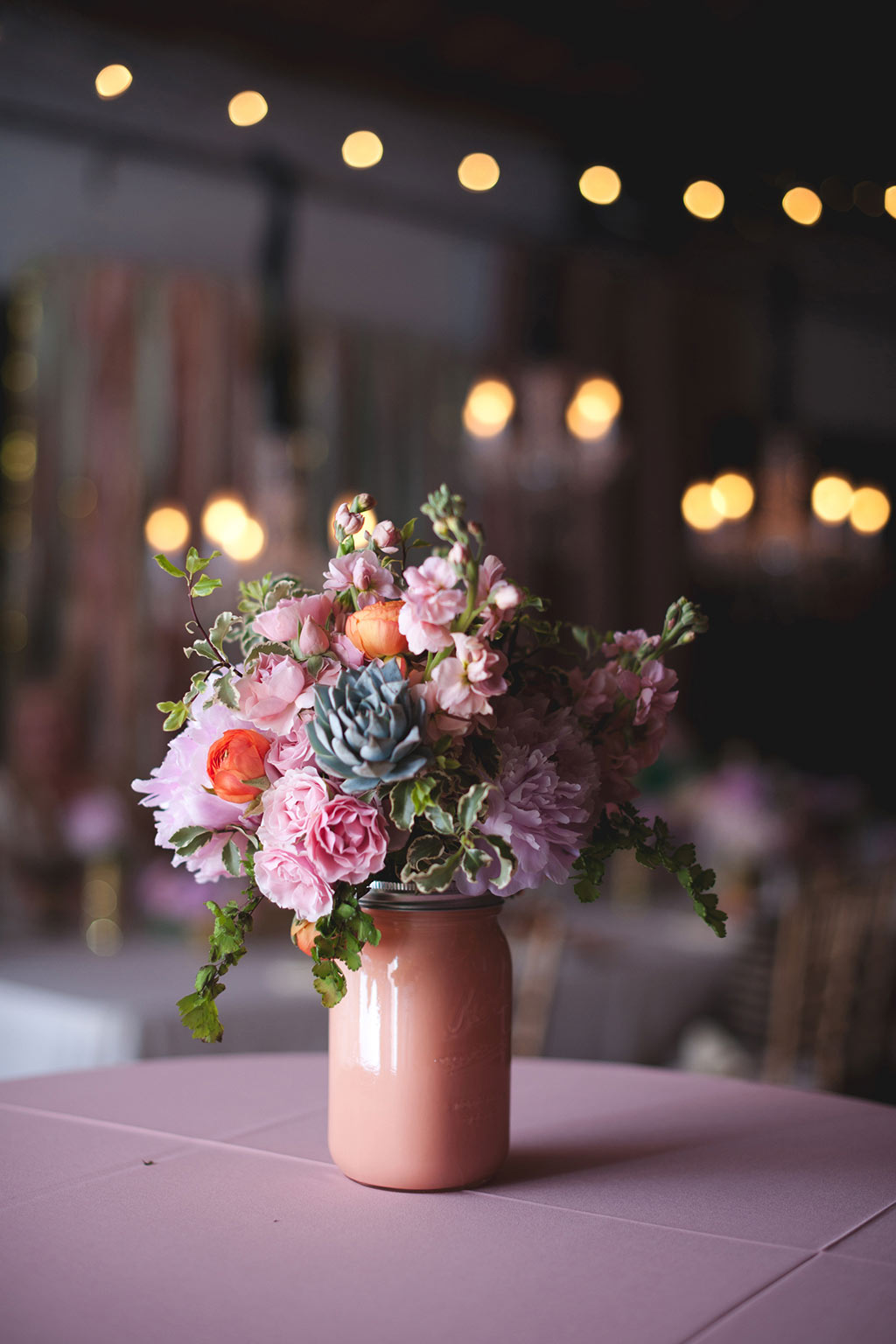 Wedding floral arrangement in peach mason jar