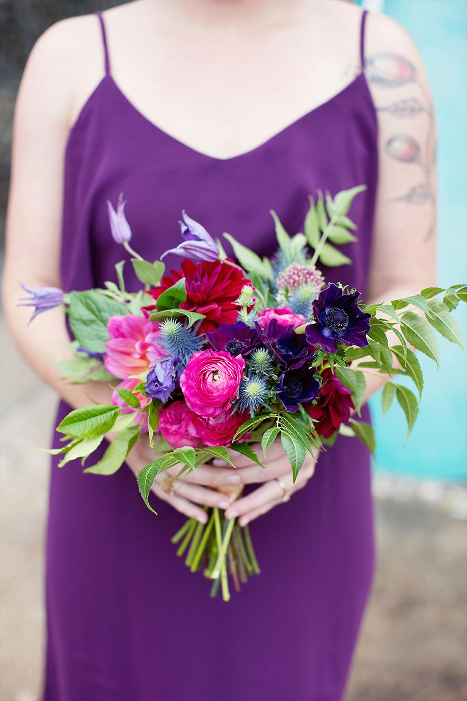 Pink and purple bridesmaid bouquet and purple dress