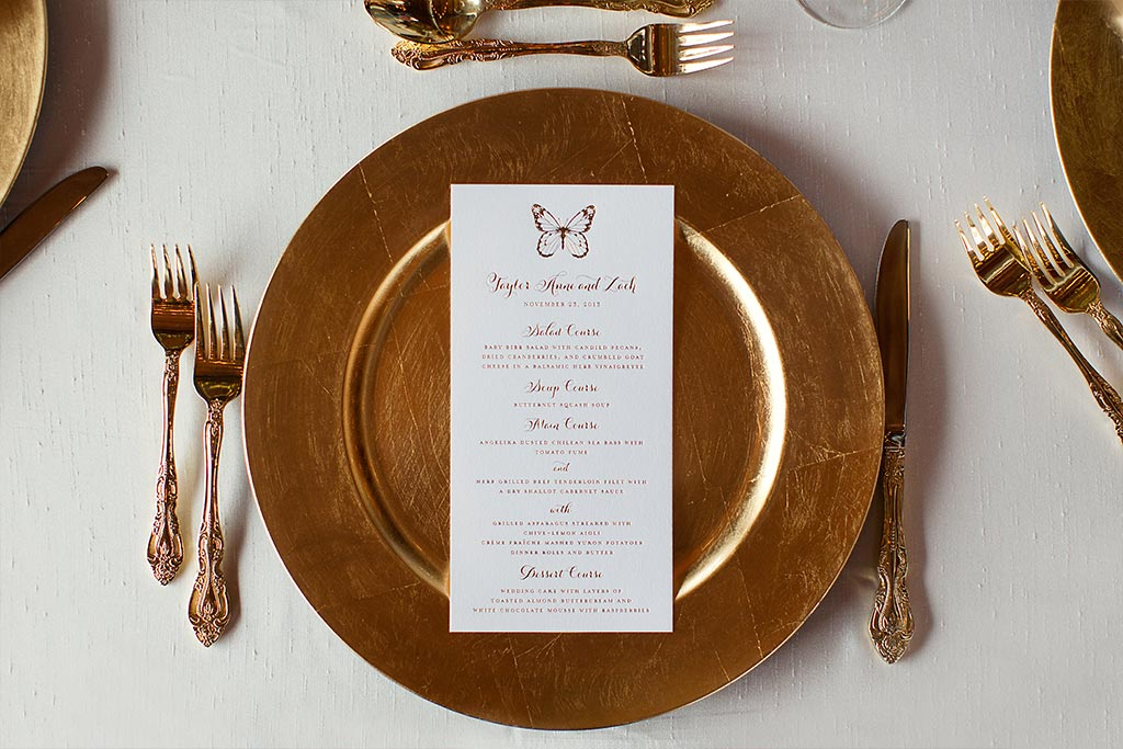 Gold wedding place setting with foil butterfly menu card