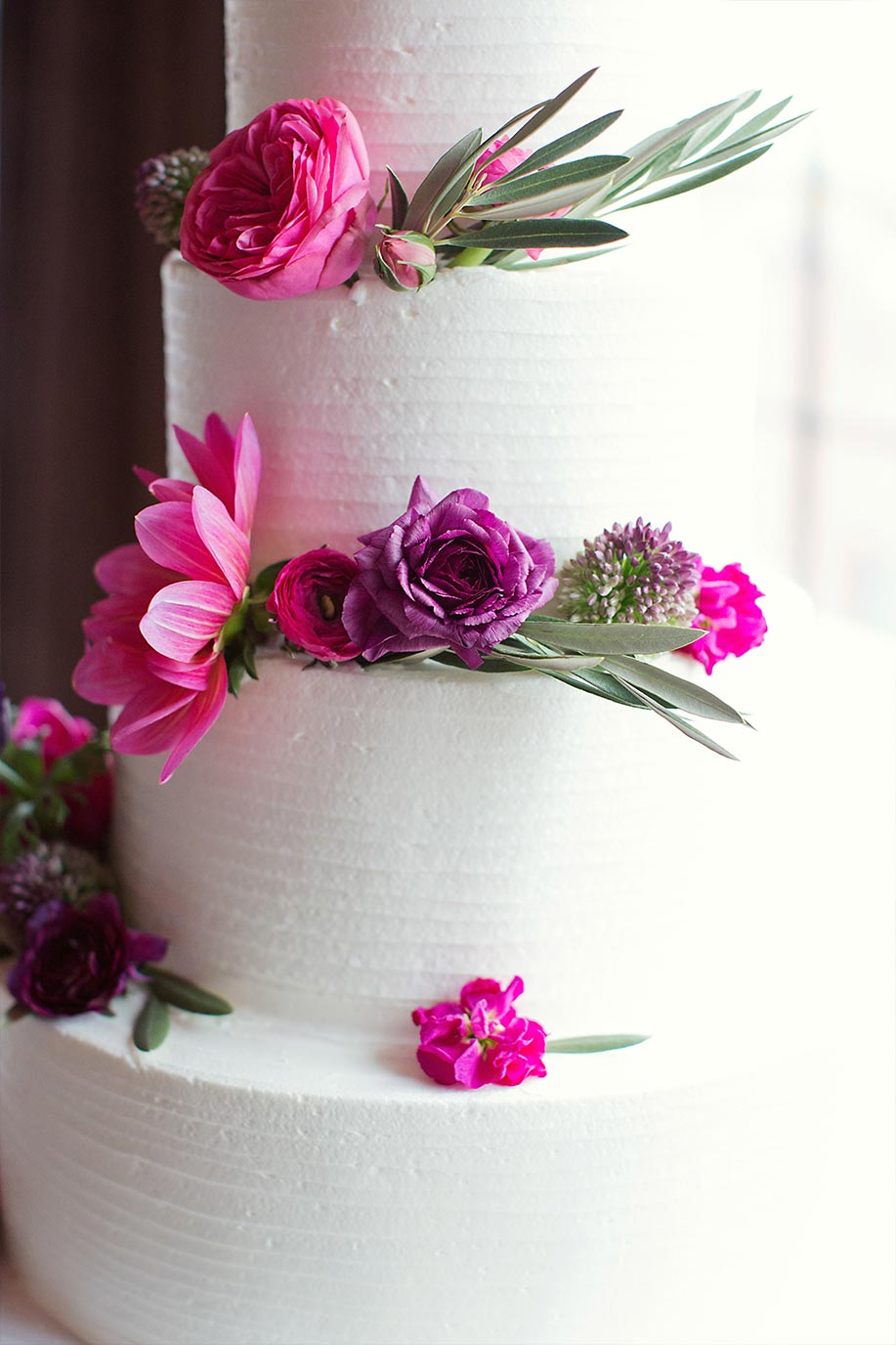 Brides cake with pink and purple flowers