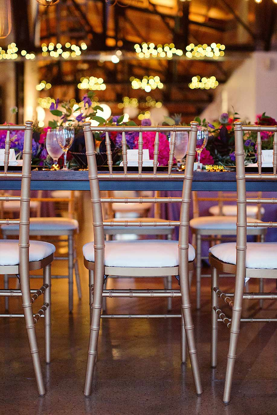Gold chiavari chairs and wedding head table